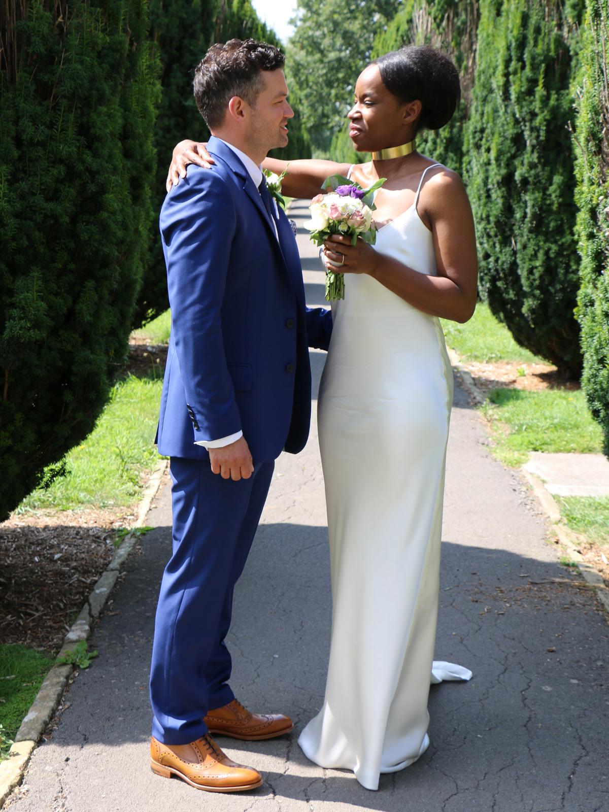 silk wedding dress and mens blue wool suit