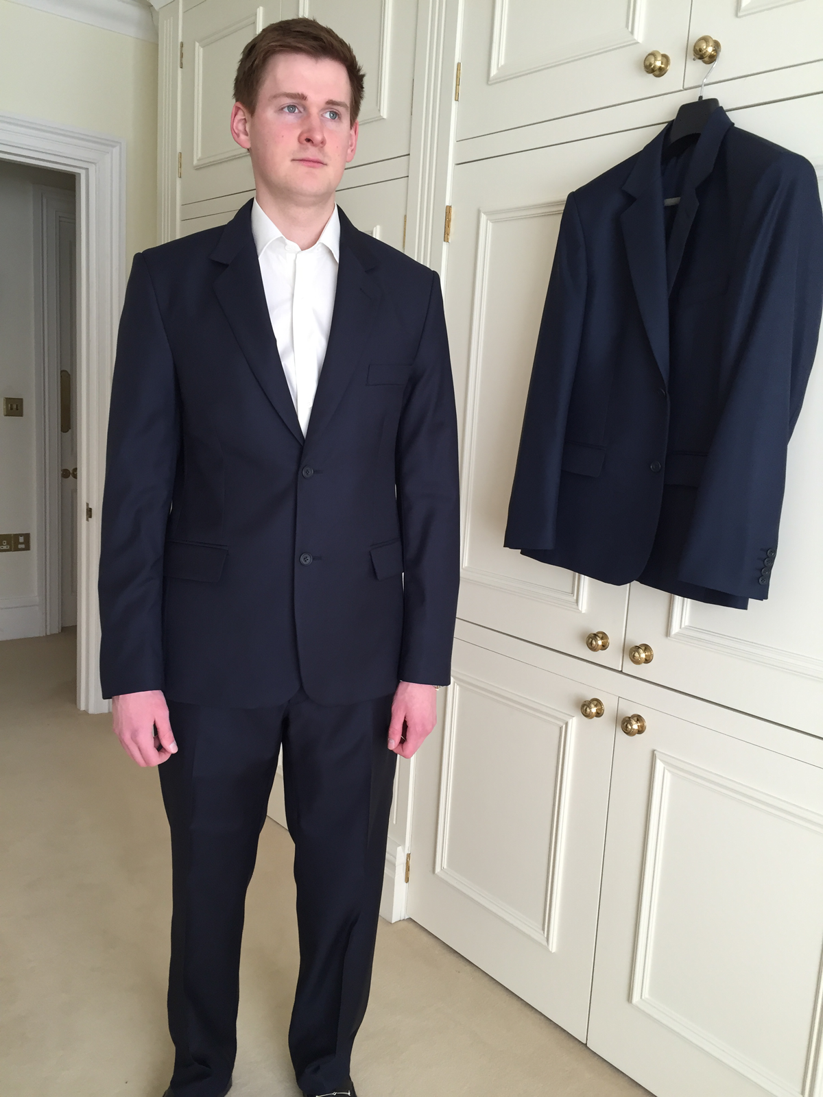 Client wearing his finished bespoke business suit